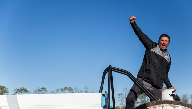 Brian Langford pumps his fist in the air as his family cheers for him after winning the Spring Classic during the Swamp Buggy Races Spring Classic at the Florida Sports Park on Saturday, March 3, 2018.