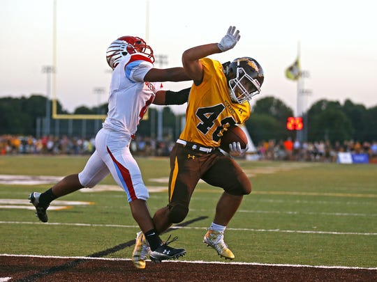 Kickapoo High School running back Malachi Stout (40)