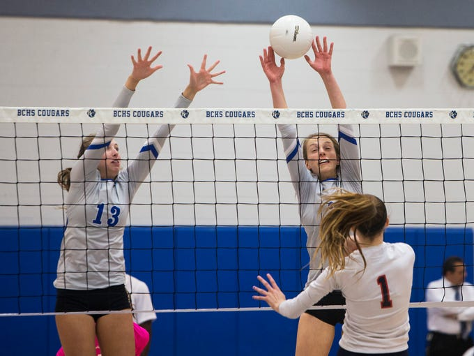 Dayna Grigsby, #2, right, and Hannah Alfes, #13, of