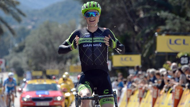 US cyclist Ben King celebrates as he crosses the finish line to win the first stage of the 84th Criterium International Cycling race on March 29, 2015 in Porto Vecchio, on the French Mediterranean island of Corsica.