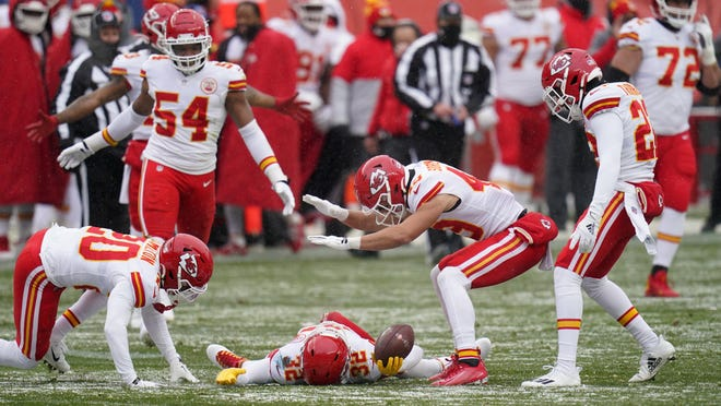 Kansas City Chiefs strong safety Tyrann Mathieu, below, reacts with teammates after picking up a fumble during the first half of Sunday's win over the Denver Broncos. The Chiefs forced four turnovers, including a pick six and also got a 102-yard kickoff return touchdown.