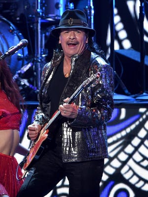 """Carlos Santana, pictured here in 2014, believes """"you have to forgive yourself every day."""""""
