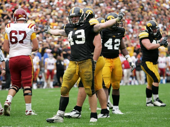 Iowa's Pat Angerer celebrates during the fourth quarter
