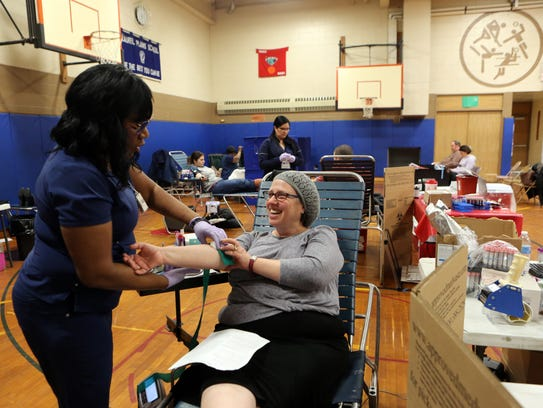 Eileen Grossman donates blood during a drive at Laurel