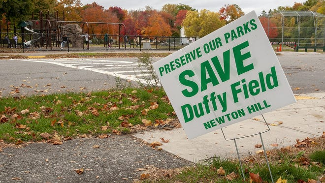 A lawn sign is seen across from Duffy Field in Worcester.