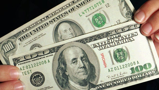 Security features of a genuine $100 billincludea 3-D security ribbon, a color-shifting bell in the inkwell, anda portrait watermark of Benjamin Franklin.