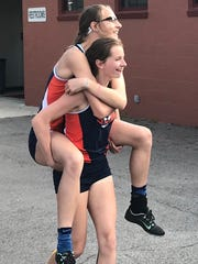 After a long day of work on the oval, Galion sophomore Kerrigan Myers gets a piggyback ride from teammate Airyona Nickels.