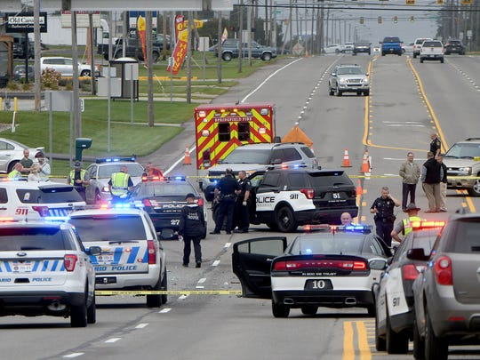 Police investigate the scene of an accident on West Fourth Street on Sept. 13, 2017 after suspects of a bank robbery lead police on a pursuit that ended in a crash in front of El Campestre restaurant.