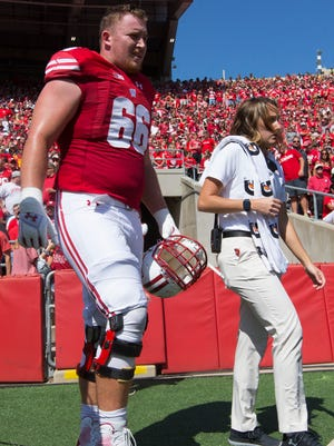 Wisconsin offensive lineman Beau Benzschawel walks to the locker room during the first quarter.