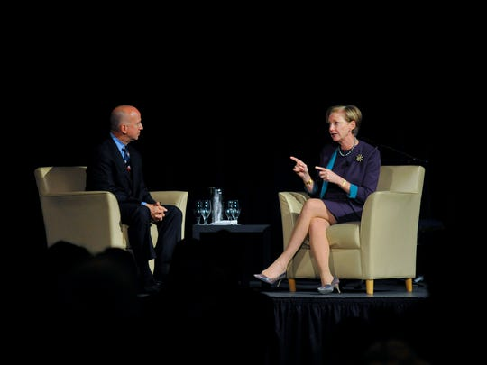 Governor Jack Markell leads a discussion with Ellen Kullman during the 2014 History Makers Award Dinner.