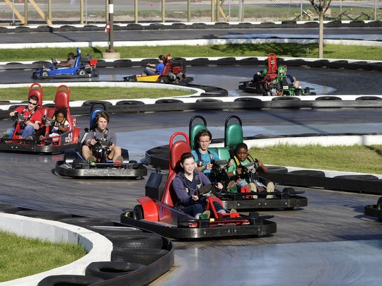 Drivers loop around the go-kart track at Thunder Road.