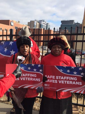 Registered nurses Sadie Hughes (left) and Audricia Brooks speak out on an informational picket line Friday outside the Cincinnati Veterans Affairs Medical Center. About two dozen nurses and veterans protested the hospital's low staffing levels.