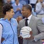 North Carolina guard Marcus Paige (5) is honored with a game by Tulane assistant coach Shammond Williams during an NCAA game in Chapel Hill, N.C., Dec. 16, 2015. Williams played college basketball 1994-1998 at North Carolina. (Photo by Sara D. Davis for Tulane)