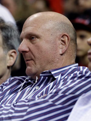 Los Angeles Clippers owner Steve Ballmer sits court side before an NBA basketball game between the Los Angeles Clippers and Miami Heat, Thursday, Nov. 20, 2014, in Miami.