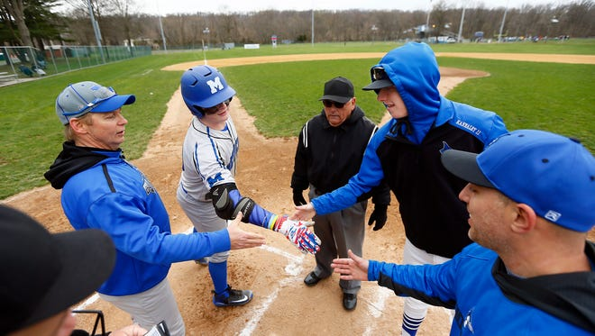 Metuchen's Manager Leo Danik and third baseman Mike Lepczynski shake hands with Middlesex's Patrick Kannaley and Manager Justin Nastasi before their game and after an 'Athlete Exchange' involving five baseball players from the two Blue Division rivals schools. April 17, 2018. Middlesex, NJ.