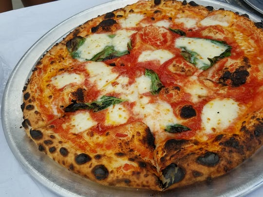 Fresh basil and mozzarella crown a wood-fired King Dough Pizza pie. The downtown Bloomington pizzeria is scheduled to land in Indy in early 2018.