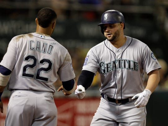 Yonder Alonso, right, will be a candidate to return as the Mariners' first baseman next year.