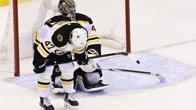 Bruins goaltender Jaroslav Halak and defenseman Torey Krug  react after losing to the Lightning, 3-2, in the second overtime of the Eastern Conference semifinal series in Toronto on Monday.
