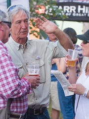 Attendees at last year's Craft Beer and Craft Festival talk over beers in Staunton.