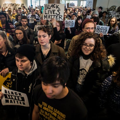 Hundreds of student protesters packed the top floor