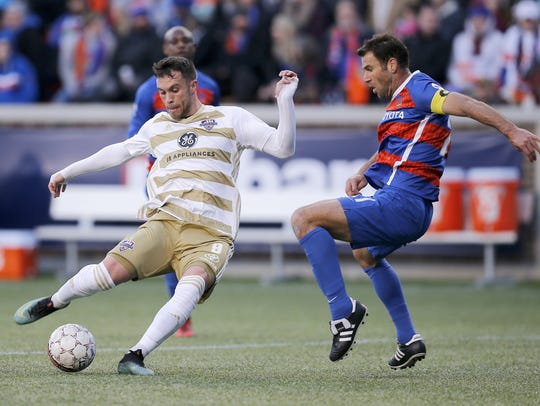 Louisville City FC's Cameron Lancaster (left) in a game earlier this year vs. FC Cincinnati.