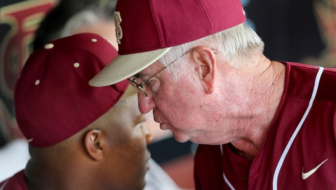 Mike Martin tells Jameis Winston that he is going in to left field as Virginia visits Florida State on Friday night for a match up of top 5 teams.