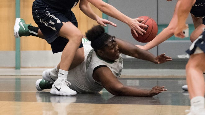 Fort Myers' Chaniya Clark fights for a loose ball  in the Green Wave's 53-48 win over  Newtown (Pa.) Council Rock North Thursday in the Naples Holiday Shootout.
