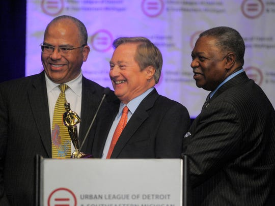 Former Michigan Gov. James Blanchard, center, smiles
