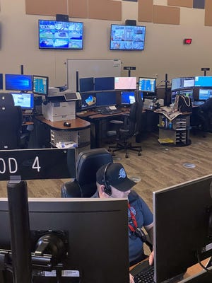 Pueblo County Sheriff Dispatcher Ben Smith (front) and Supervisor Dani Perea (background) are able to be more efficient thanks to $389,000 worth of upgrades to the 911 center.