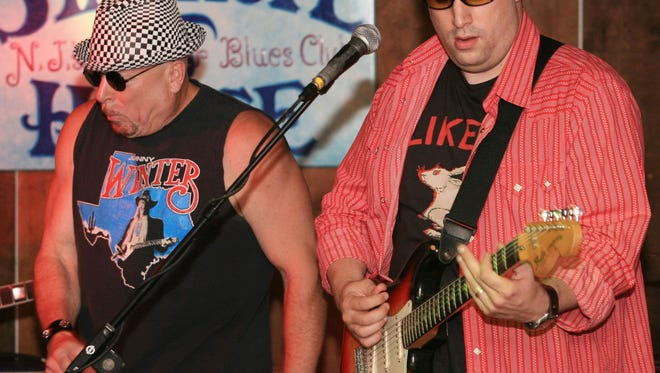 Future Stanhope House owner Jon Klein, left, and his son Matt play at the historic blues roadhouse in 2006.