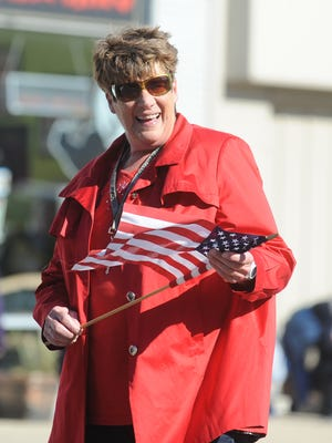Richmond Mayor Sally Hutton greets people along the route of the Richmond Veterans Day Parade on East Main Street on Nov. 9, 2013.