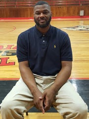 Former USM player Eric Booth is Collins' new football coach.