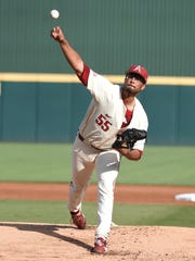 Arkansas pitcher Isaiah Campbell delivers against South Carolina on Monday night at Baum Stadium.
