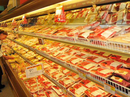The new Publix on Highway 50 in Titusville. Meat cutter Mykila Doerflein stocks up meat cuts in the meat department.