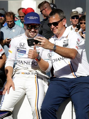 McLaren-Honda-Andretti IndyCar driver Fernando Alonso (29) takes a selfie with a crew member after getting bumped off of the pole position during Armed Forces Pole Day Sunday, May 21, 2017, afternoon at the Indianapolis Motor Speedway.