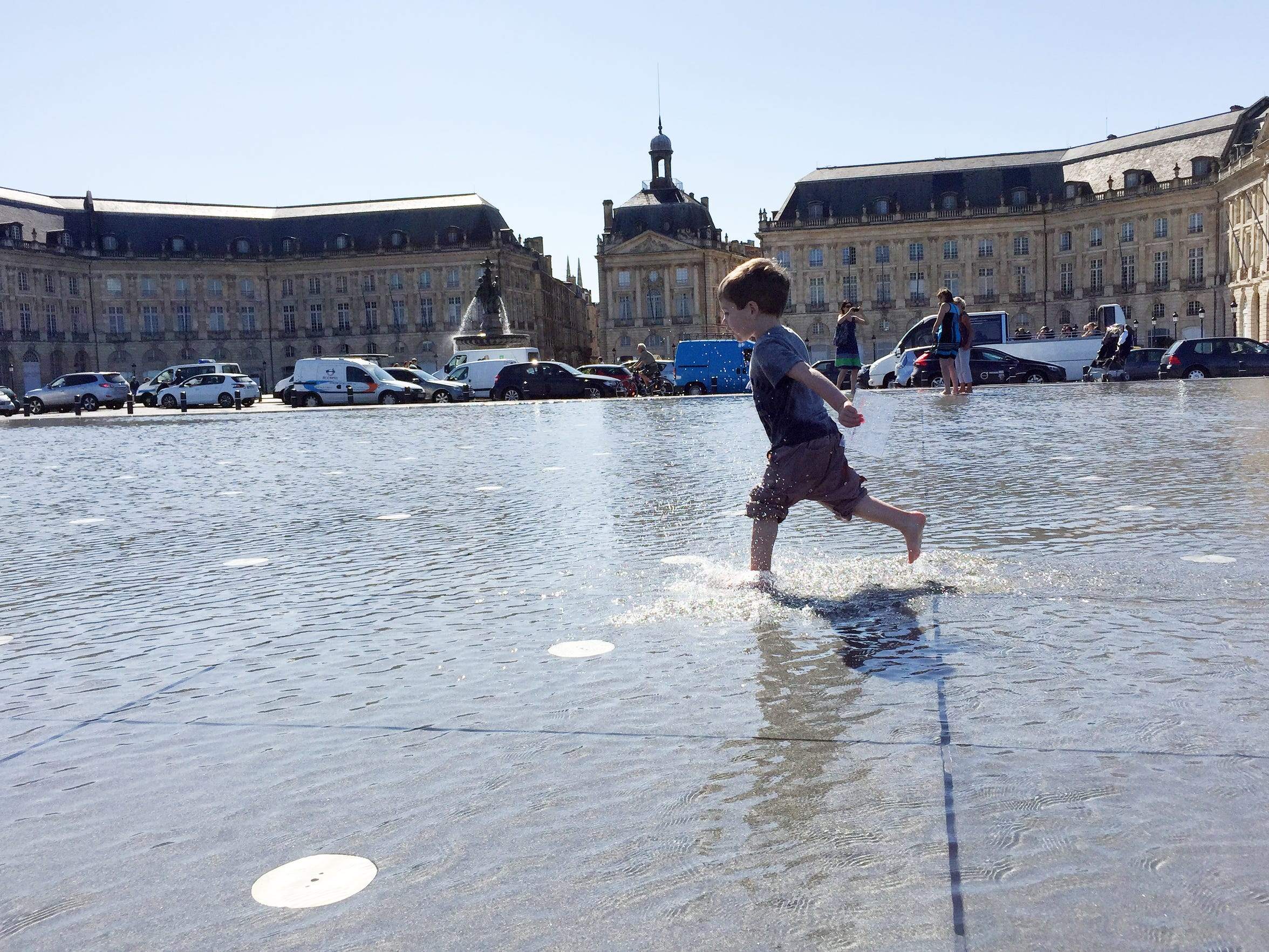 Walker Hughey, 2, runs through the two inches of water