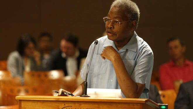 Edward Holifield speaks during the public comment period of a CRA meeting this summer at City Hall.