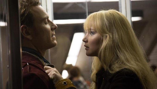 "Michael Fassbender and Jennifer Lawrence in a scene from ""X-Men: Days of Future Past."""