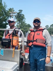Mississippi fishing guides Ronnie Daniels, left, and