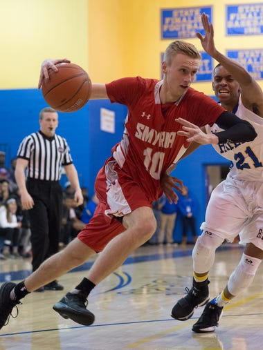 Smyrna's Caleb Matthews (10) drives to the hoop past
