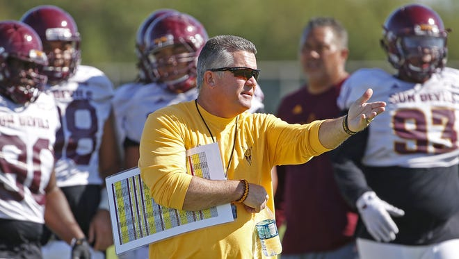 Arizona State football coach Todd Graham instructs his team during a practice at in Tempe on August 15, 2016.