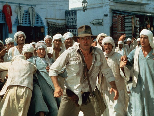 "Harrison Ford as Indiana Jones and ""Raiders of the Lost Ark"" exploded in theaters in 1981, the top grossing film of the year."
