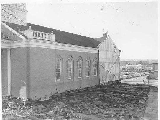 Screw jacks and stacks of wood beams called cribbing were used to raise and support Salem First Presbyterian Church while roller dollies permitted the frame to move along a track system during its move diagonally across the intersection of Chemeketa and Winter streets NE in 1958-59.