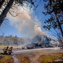 Smoke from a brush/barn fire in Georgia rises on horizon north of Burlington.