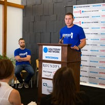 """Cubs first baseman Anthony Rizzo speaks during the """"Cancer Knows No Borders"""" announcement."""