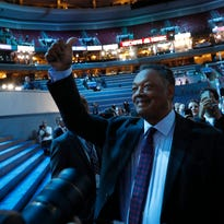 The Rev. Jesse Jackson give a thumbs up in front of the stage before the kickoff of the Democratic National Convention in Philadelphia , Sunday, July 24, 2016. (AP Photo/Paul Sancya)