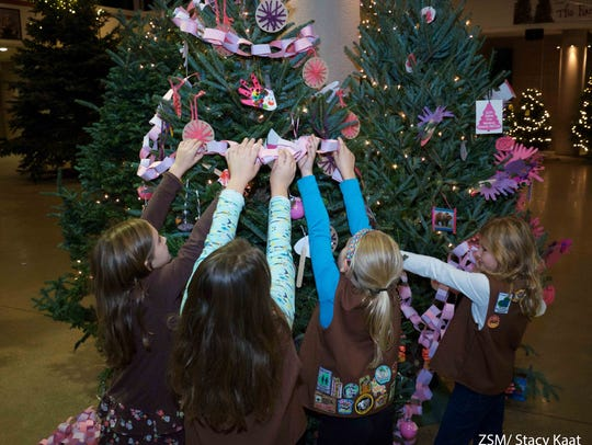 Scout groups are among the youth groups which decorate