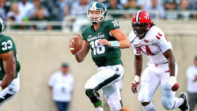 MSU junior quarterback Connor Cook scrambles out of the pocket against Jacksonville State. Cook completed 12 of 13 passes for 285 yards and three touchdowns in MSU's 45-7 win.