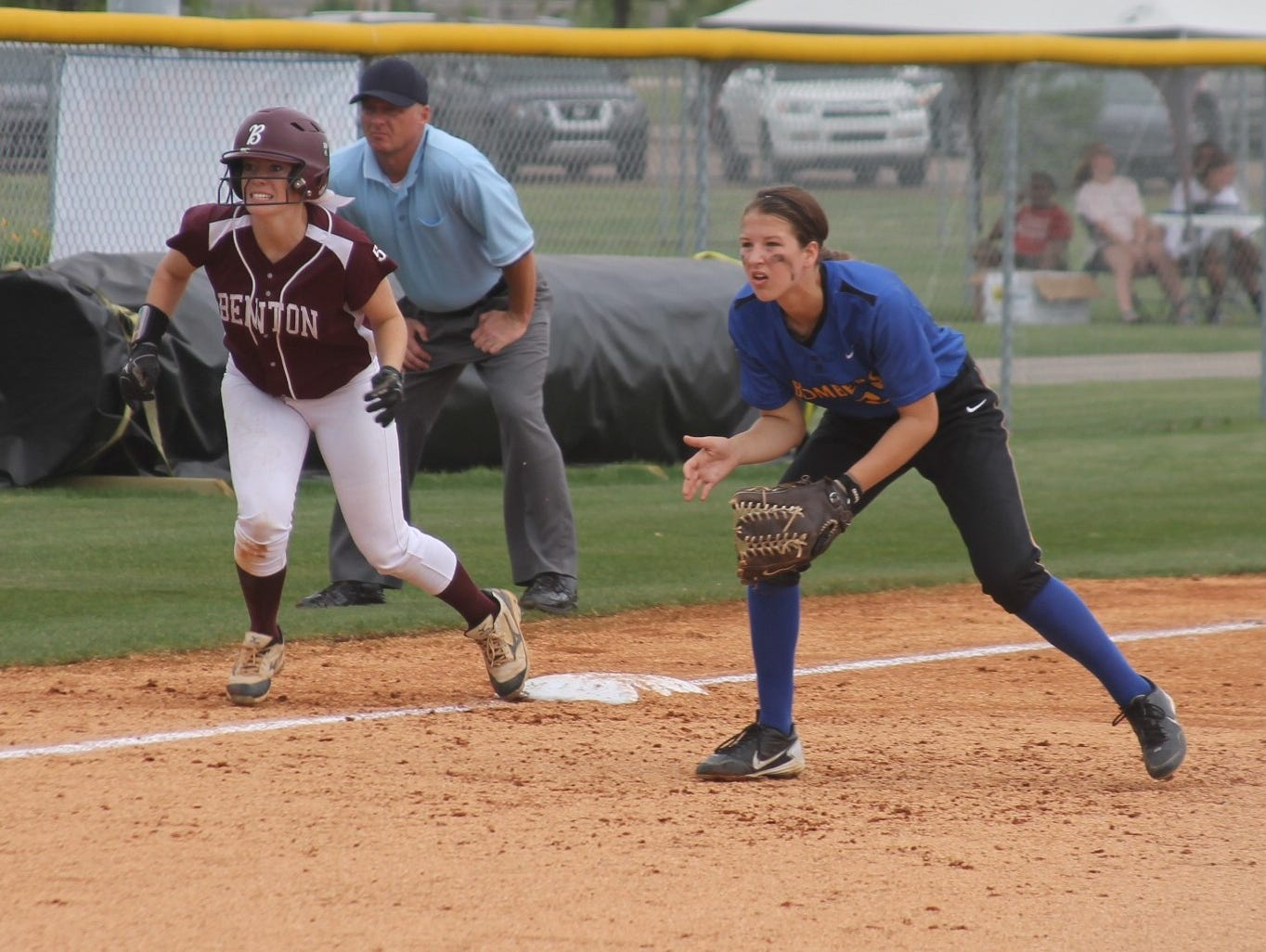 Mountain Home's Maly Tabor, right, gets ready to field the ball at third base as a Benton baserunner takes off during the Lady Bombers' 10-0 loss to the Lady Panthers in the quarterfinals of the Class 6A State Softball Tournament on Friday at Marion.