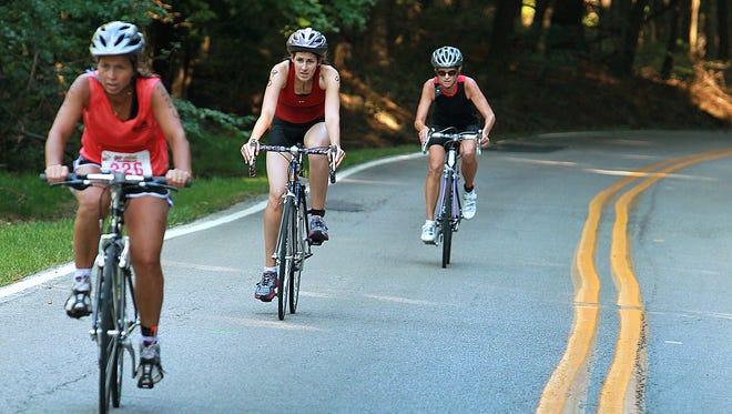 Women bike during the 2013 Go Girls Triathlon in Eagle Creek Park, Saturday, Aug. 24, 2013.